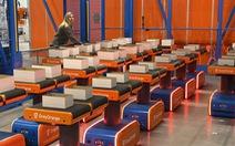 Bỉ sử dụng người máy để đóng gói bưu kiện