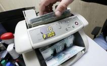 Nga buộc doanh nghiệp bán ngoại tệ cứu đồng ruble