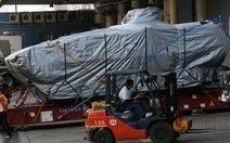 Xe bọc thép bị Hong Kong bắt giữ về đến Singapore