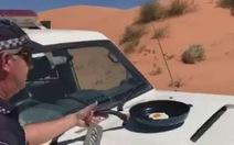 Nắng nóng kỷ lục, cảnh sát Úc chiên trứng trên... mui xe