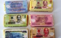 Xem xét vi phạm dùng giấy in hình tiền để gói kẹo
