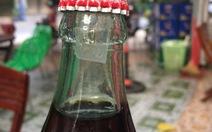Phát hiện chai Coca-cola có 'dị vật' giống như thuốc