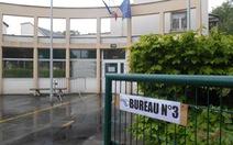 Người Pháp bầu cử trong mưa