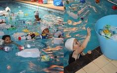 Trường cho học sinh bơi trong bể 'ô nhiễm' để dạy về rác nhựa