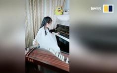 Bé gái 9 tuổi có thể chơi đàn tranh và piano cùng lúc