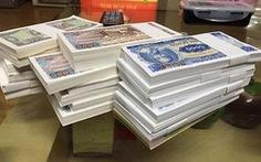 Thu phí đổi tiền mới là vi phạm pháp luật