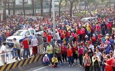 Công nhân Pouchen tràn ra quốc lộ 1K phản đối thang lương mới