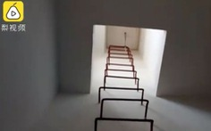 Trung Quốc: Khóa lối lên nóc nhà vì sợ người thua cá độ World Cup tự tử