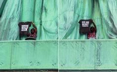 Người biểu tình leo lên tượng nữ thần Tự Do phản đối luật nhập cư
