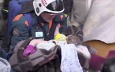 Tìm thấy bé 11 tháng tuổi còn sống trong đống đổ nát chung cư Nga