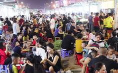 Dân vô tư ngồi ăn uống trên đường điện ở phố đêm đầu tiên Nghệ An