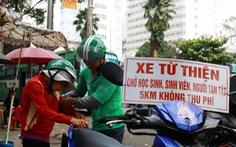 'Thằng hâm' chạy Grab miễn phí khắp Sài Gòn