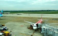 Chuyến bay hạ cánh khẩn cấp ở Tân Sơn Nhất do pin dự phòng nổ, hành khách có lỗi?