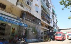 Sớm tháo dỡ, xây mới lô E chung cư 518 Võ Văn Kiệt
