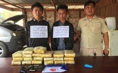 Phối hợp bắt nóng bên Lào hai tên thủ súng, mang theo 118.000 viên ma túy