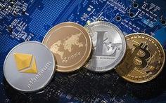 Bitcoin tăng vọt, sắp chạm 6.000 USD