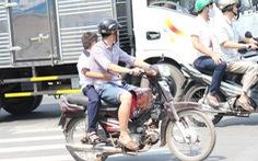 Chở trẻ em không đội mũ bảo hiểm bị phạt nghiêm từ tháng 9