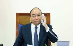 Thủ tướng Nguyễn Xuân Phúc mời Thủ tướng Nhật Suga Yoshihide thăm Việt Nam