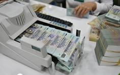 Cấm ngân hàng ép khách hàng vay vốn mua bảo hiểm