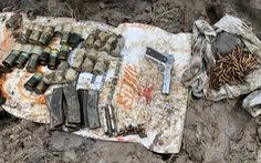 Người dân phát hiện nhiều súng, đạn khi xúc đất