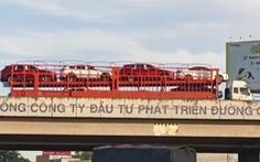 Xác minh clip xe đầu kéo chở 8 xe con đi lùi hàng trăm mét trên cao tốc