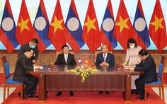 Quan hệ Việt - Lào: 'Hạt muối cắn đôi, cọng rau sẻ nửa'