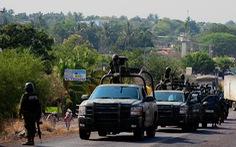 Tìm thấy 12 thi thể đầy vết đạn chất trên xe bán tải