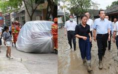 Lũ ngập Trùng Khánh, xe hơi bị 'gói' trong bao nhựa