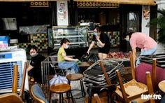 Hàng quán Đà Nẵng lau dọn đồ nghề trước ngày mở cửa bán tại chỗ 16-10