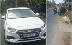 Đi xe hơi ép xe máy cảnh sát hình sự để cướp súng và ví