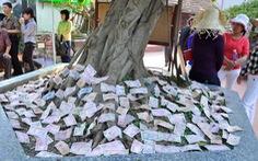 Bộ Tài chính đề xuất khuyến khích người dân chuyển khoản tiền công đức