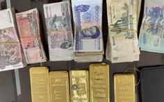 Bắt quả tang người phụ nữ vận chuyển 5kg kim loại nghi là vàng 9999