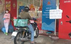 Người dân TP.HCM cầm phiếu đi siêu thị theo khung giờ