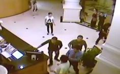 Người mặc cảnh phục mang súng AK là thiếu úy công an