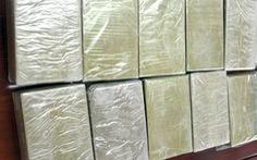 Bắt nghi phạm ôm 20 bánh heroin từ Lào về Việt Nam