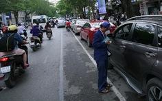 Hà Nội thí điểm thu tiền giữ xe qua điện thoại di động