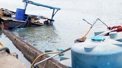 Thuyền chứa 26 tấn axit chìm dưới sông Đồng Nai