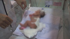 Phẫu thuật khối bướu nặng 3,1kg cho bé sơ sinh 1 ngày tuổi