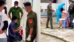 Video: Nhiều người cùng công an đến một căn hộ, phá cửa vào nhà cưỡng chế phụ nữ đi test COVID
