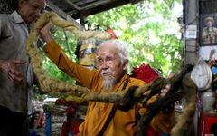 Cụ ông Việt Nam không cắt tóc 80 năm vào top ảnh 'kỳ quặc' nhất thế giới