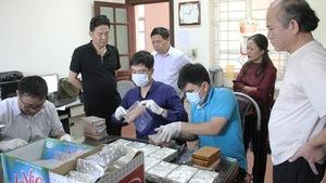 Bắt giữ 40 bánh heroin trong chiếc ôtô công vụ ở Lào Cai