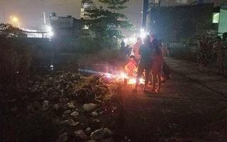 Đi bắt ếch, 2 người đàn ông thấy xác chết nổi trong rác
