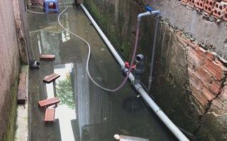 Nhà ngập nước, một phụ nữ bị điện giật chết