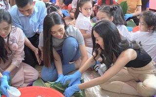 Video: Hoa hậu Tiểu Vy gói bánh chưng tặng trẻ em vùng cao