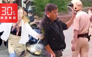 Bản tin 30s Nóng: Tạm giữ người dùng dép đánh vào mặt CSGT; Nữ đầu bếp làm xiếc với chảo