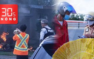 Bản tin 30s Nóng: Đổ xô mua bảo hiểm lề đường đối phó CSGT; Máy bay lao xuống nhà dân