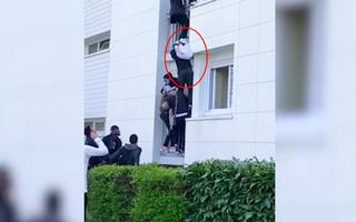 Video: Bé 6 tháng tuổi thoát chết khi rơi từ tầng 3 căn nhà đang cháy