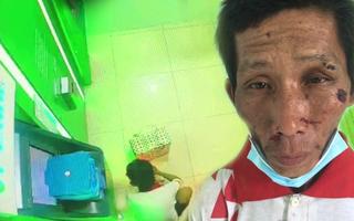 Video: Người tâm thần đốt giấy trong trụ ATM, gây cháy ngân hàng tại Rạch Giá