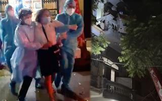 Video: Phải điều xe thang cưỡng chế một phụ nữ đi cách ly tập trung