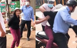 Video: Người phụ nữ cởi khẩu trang thách thức lực lượng chống dịch, bị phạt 2 triệu đồng
